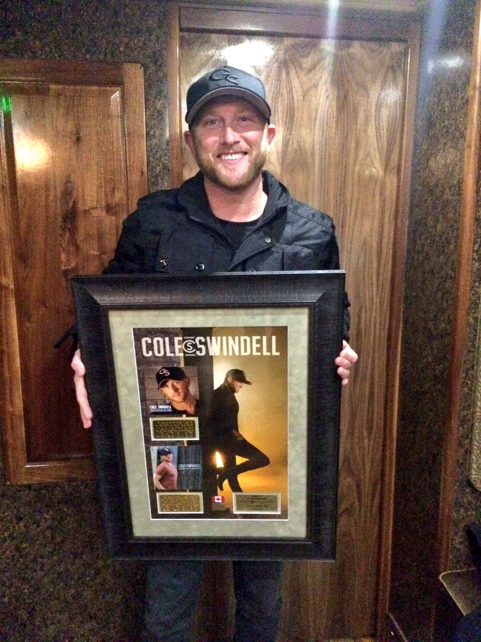 Cole Swindell surprised with plaque in Hamilton for Gold